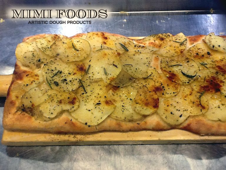 Focaccia with sliced potatoes and balsamic caramelized onions