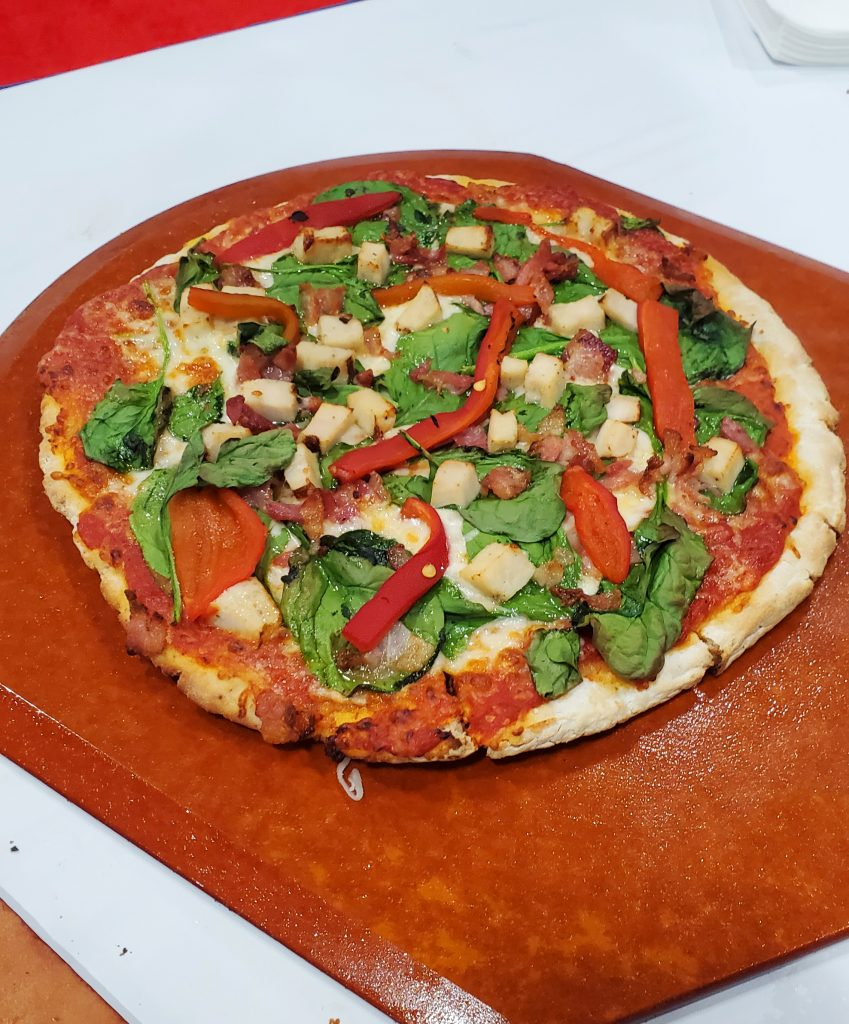 Cauliflower pizza crust loaded with toppings